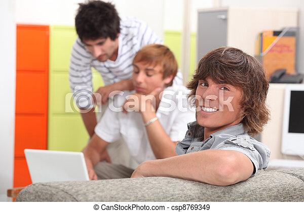 Three boys in the classroom - csp8769349