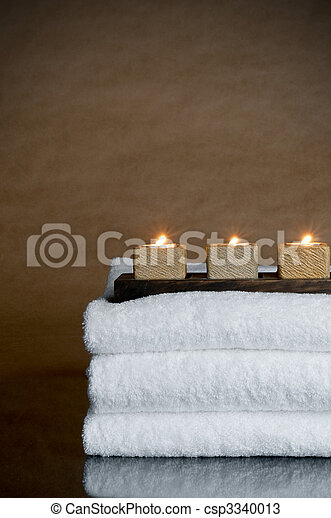 Three candles on three spa towels - csp3340013