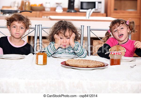 three children eating crepes - csp8412014