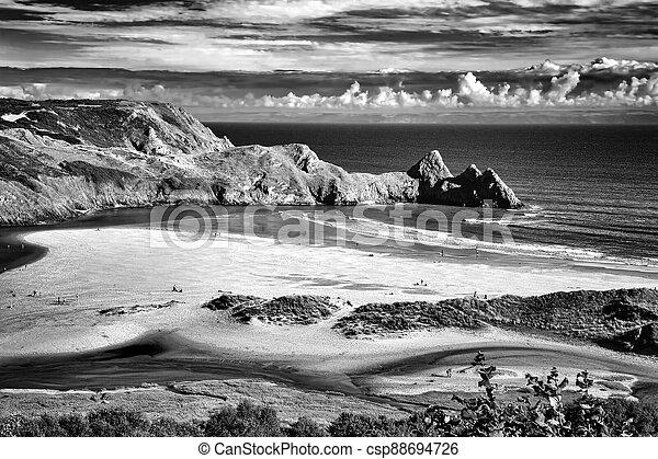 Three Cliffs Bay beach on the Gower Peninsular West Glamorgan Wales UK, which is a popular Welsh coastline travel destination - csp88694726
