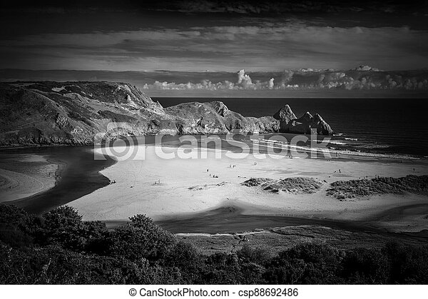 Three Cliffs Bay on the Gower Peninsular West Glamorgan Wales UK which is a popular Welsh coastline attraction - csp88692486