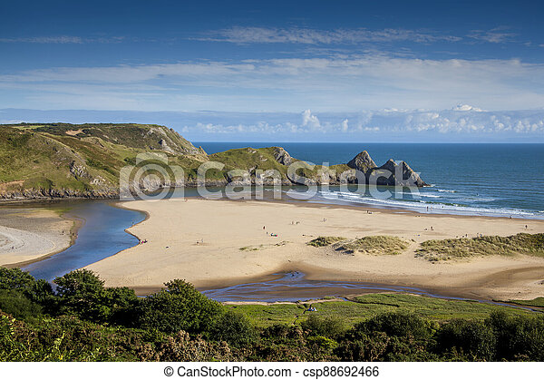 Three Cliffs Bay on the Gower Peninsular West Glamorgan Wales UK which is a popular Welsh coastline attraction - csp88692466