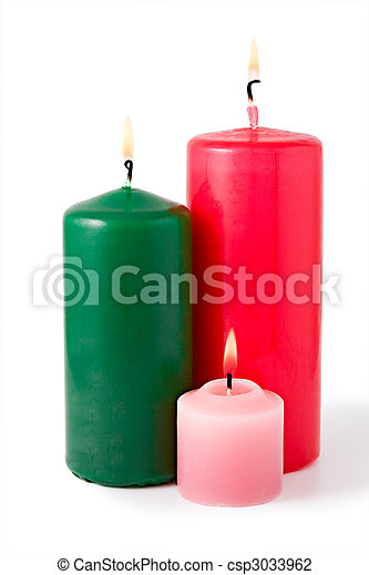 Three colored burning candles. Isolated on white - csp3033962