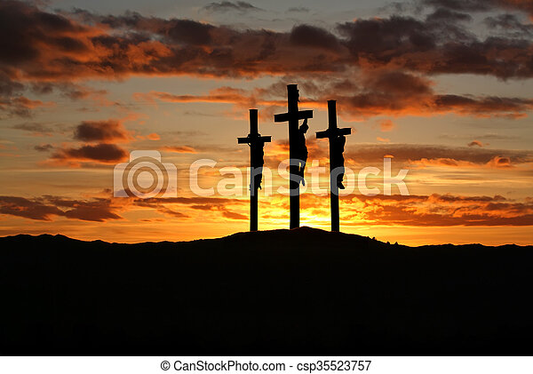 Three crosses over bright sunset with copy space - csp35523757