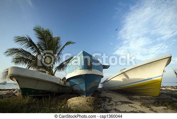 three fishing boats on shore caribbean sea - csp1360044