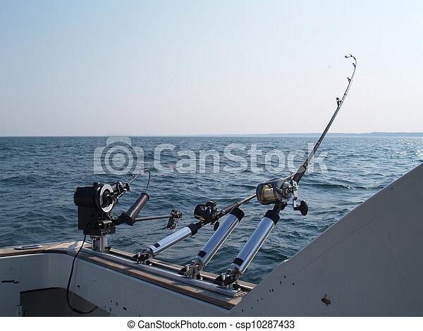 Three Fishing Poles Set Up For Trol - csp10287433