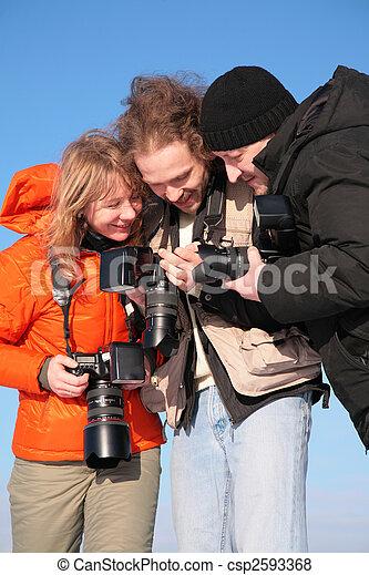 three fotographers against blue sky 3 - csp2593368