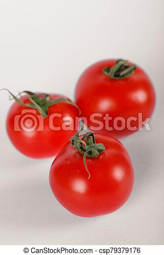 Three fresh tomatoes on white background - csp79379176
