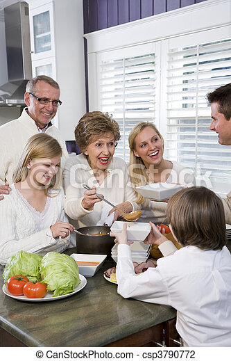 Three generation family in kitchen eating lunch - csp3790772