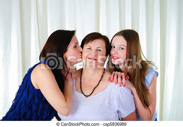 three generations of women together - csp5836989