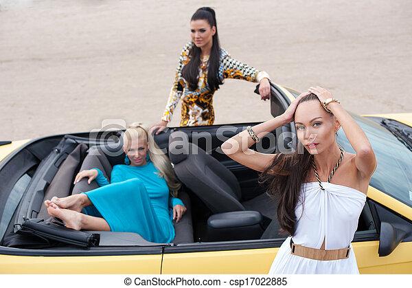 Three Girls With Sport Car Three Girls With Sport Car On A Beach