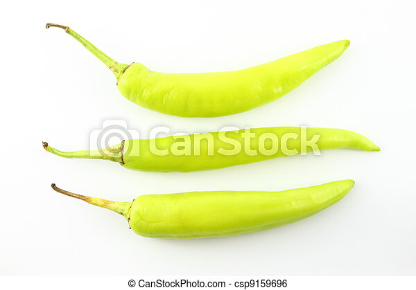 Three green chili peppers on white background. - csp9159696