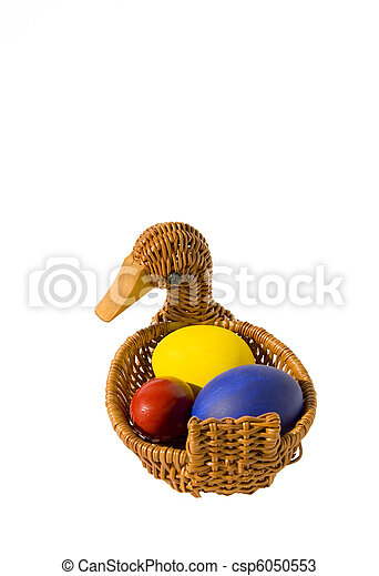 three isolated color Easter eggs in basket - csp6050553