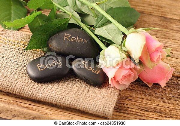 Three lava stones and three beautifull pink roses - csp24351930