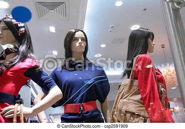 three mannequins in store - csp2591909