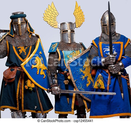 Three medieval knights isolated on grey background. - csp12455441