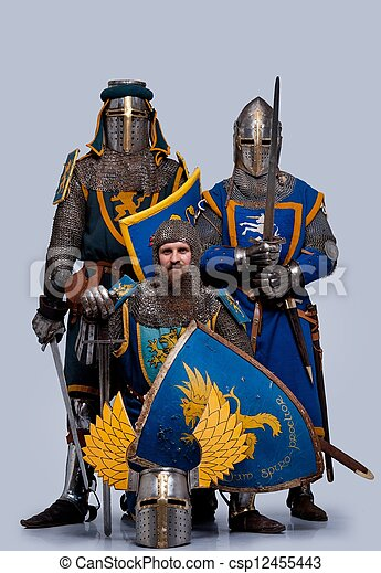 Three medieval knights isolated on grey background. - csp12455443