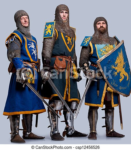 Three medieval knights isolated on grey background. - csp12456526