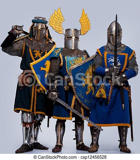 Three medieval knights isolated on grey background. - csp12456528