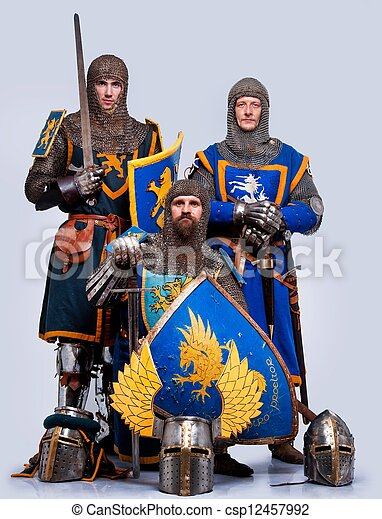 Three medieval knights isolated on grey background. - csp12457992
