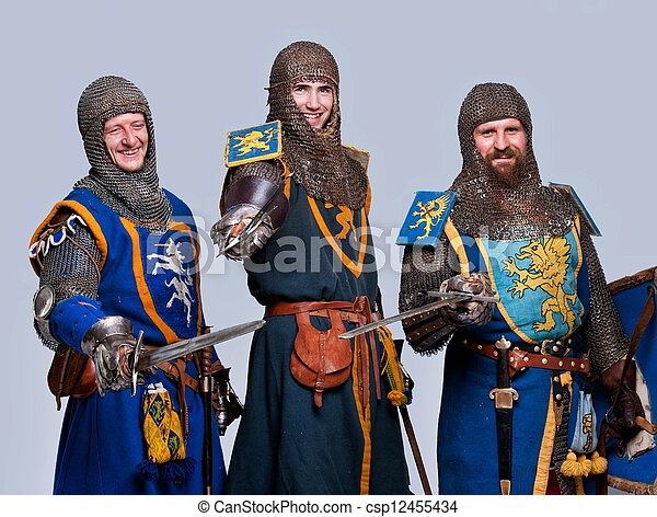 Three medieval knights isolated on grey background. - csp12455434