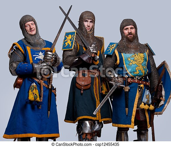 Three medieval knights isolated on grey background. - csp12455435