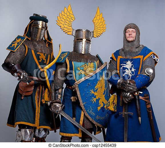 Three medieval knights isolated on grey background. - csp12455439