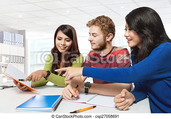 Three multicultural student, studying together - csp27058691