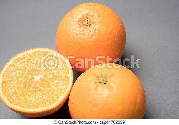 Three oranges on grey background - csp44702239