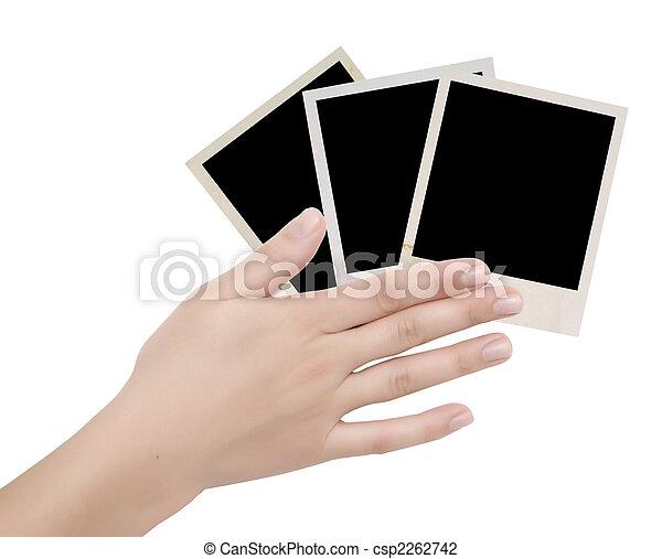 three photo frames in a hand - csp2262742