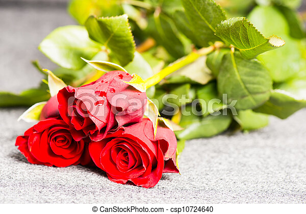 Three red roses on a cloth - csp10724640