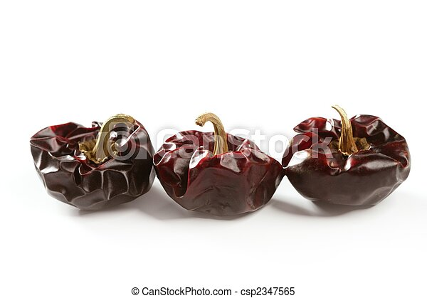 Three round Mediterranean dried dark red peppers - csp2347565