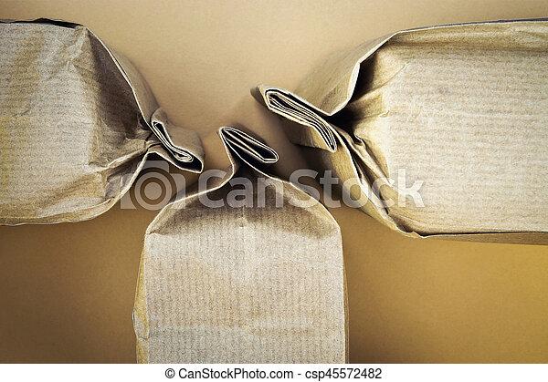 three sealed paper bags - csp45572482