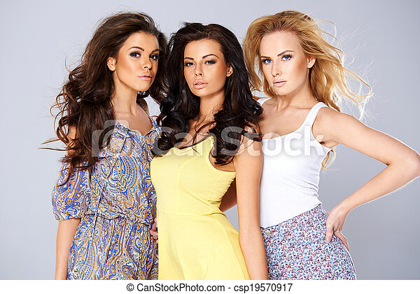 Three sexy chic young women in summer fashion - csp19570917