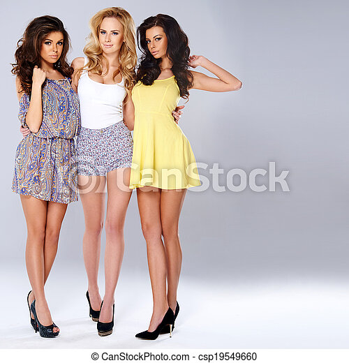 Three sexy chic young women in summer fashion - csp19549660