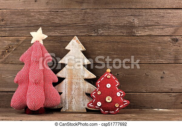 three shabby chic christmas trees against wood csp51777692 - Handmade Shabby Chic Christmas Decorations