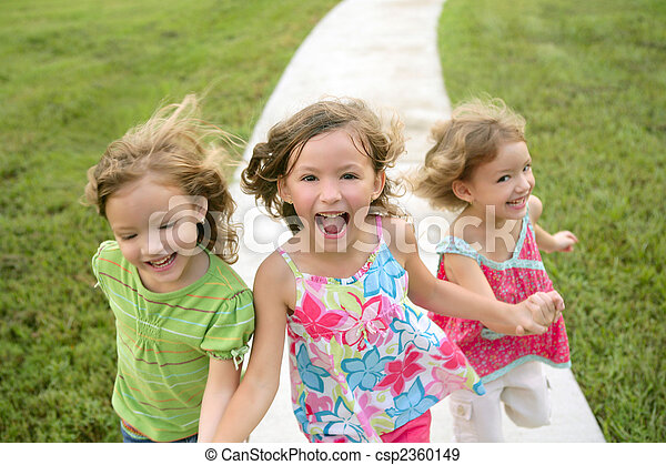 Three sister girls playing running on the park - csp2360149