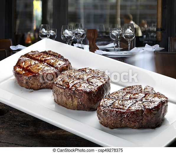 Three steaks roasted on the grill - csp49278375