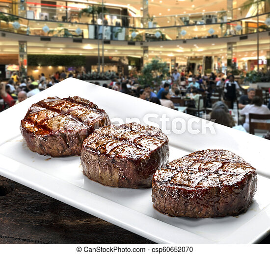 Three steaks roasted on the grill - csp60652070