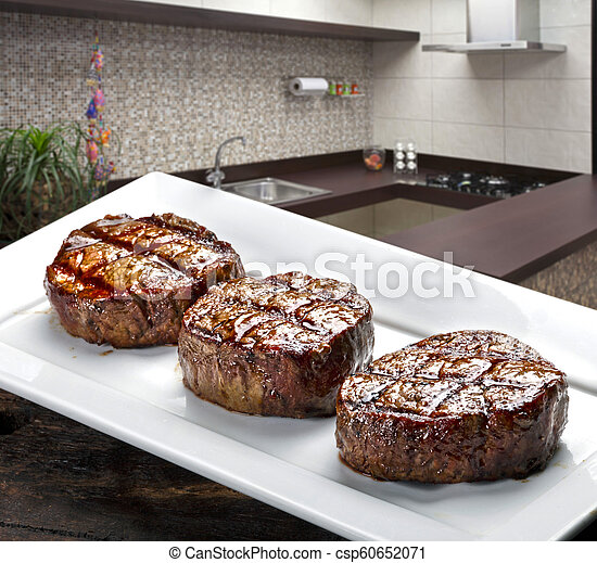 Three steaks roasted on the grill - csp60652071