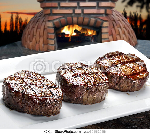 Three steaks roasted on the grill - csp60652065