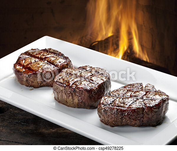 Three steaks roasted on the grill - csp49278225