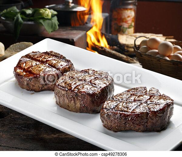 Three steaks roasted on the grill - csp49278306