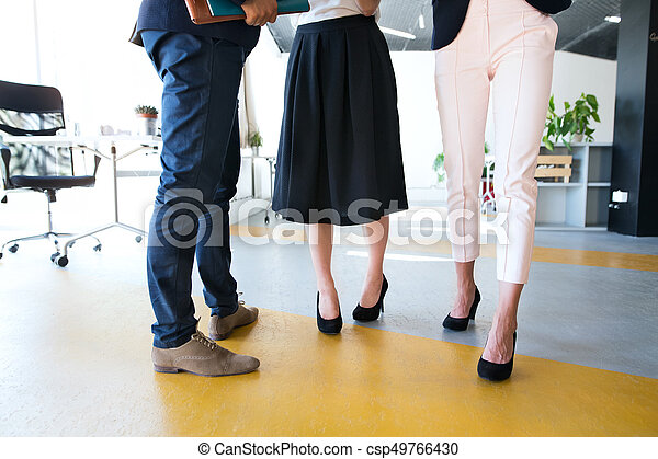 Three unregognizable business people in the office. - csp49766430