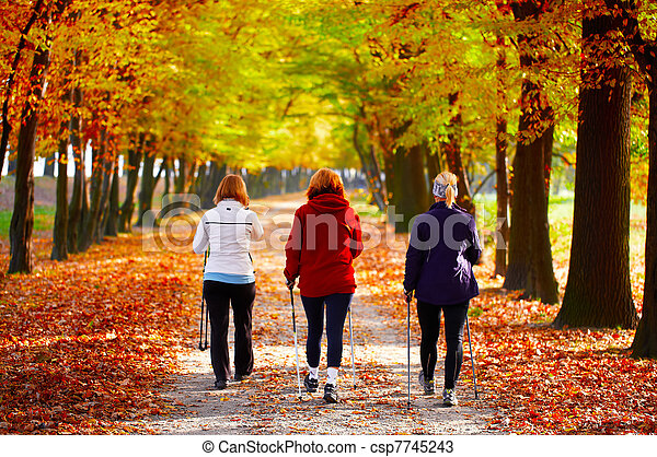 Three women in the park - Nordic walking - csp7745243