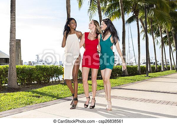 Three women walking - csp26838561