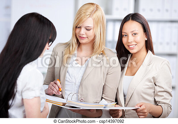 three young businesswomen in the office - csp14397092