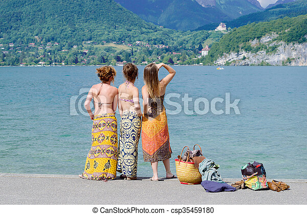 Three young women at the waterfront of lake - csp35459180