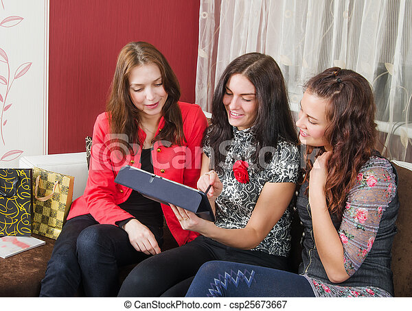 Three young women friends chatting - csp25673667