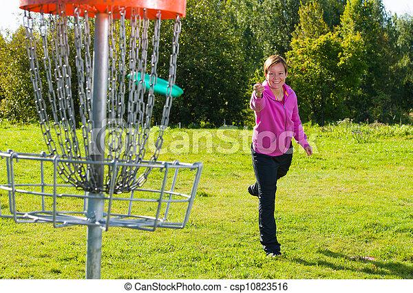 Throwing a disc - csp10823516